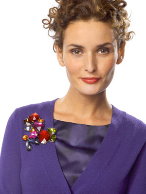 model with brooch on shoulder
