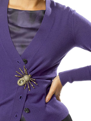 model with brooch on cardigan
