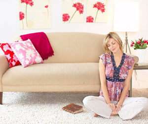 woman relaxing in front of couch