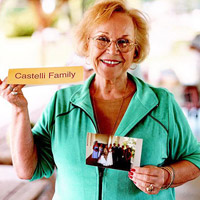 Woman holding family sign and photo