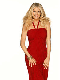 Christie Brinkley modeling in red dress