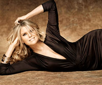 Christie Brinkley modeling in black dress