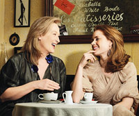 Meryl Streep and Amy Adams smiling at each other