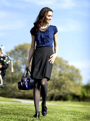Model with pleated skirt and blue top