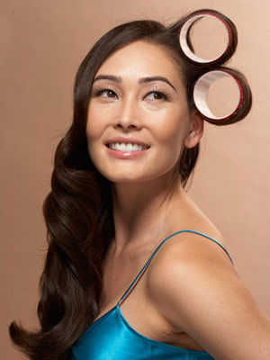 model with curlers in hair
