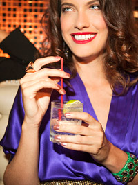 Model in purple top with drink