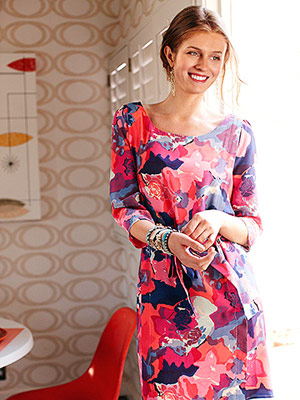 Model standing in floral dress