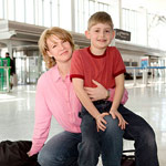 Mother and son in airport