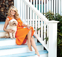 Christie Brinkley sitting on steps
