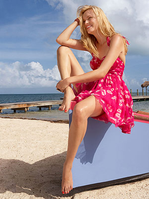 Model in hot pink sundress