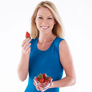 woman snacking on strawberries
