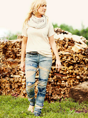 Woman wearing distressed jeans