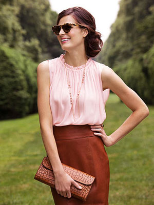 Model in pink shirt and brown skirt