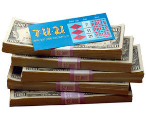 Stack of money with lottery ticket on top