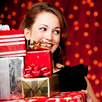 woman carrying wrapped presents