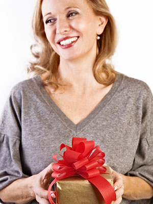 ihj.com tryahairstyle. woman holding present. iStockphoto