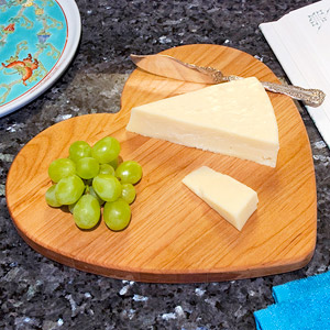 Heart cutting board with cheese and grapes