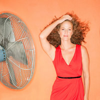 Model in front of fan