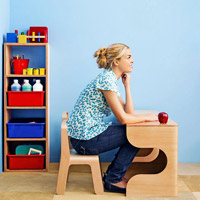 Model sitting at desk