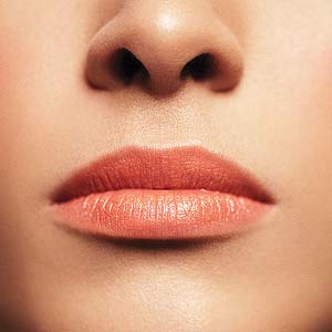 Model with light coral lipstick