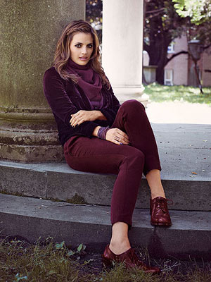 Model in burgundy outfit
