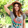 Woman in tee with parrots and fedora hat