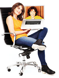 Tina Fey holding laptop with Lily Tomlin's face on screen