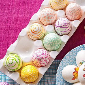 Three sets of differently decorated Easter eggs