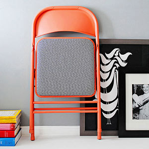 Orange folding chair with patterned cushion