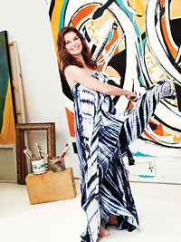 Sela Ward in blue tie dye dress in art studio