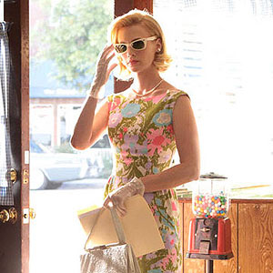 Betty in floral dress and sunglasses