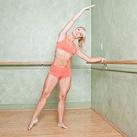 Tracy Mallett stretching by ballet barre