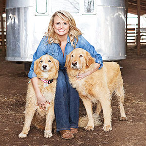 Miranda Lambert with two golden retriever dogs