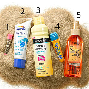 Five sunscreens on sand