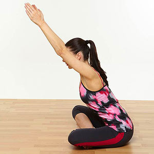 Cross-legged lower back stretch