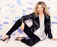 Michelle Pfeiffer sitting down with black leather jacket and black pants