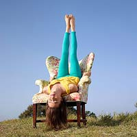 Woman sitting upside down in chair