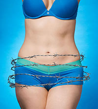 Woman with barbed wire around tummy