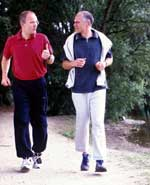 Two Men Talking During Run in Park