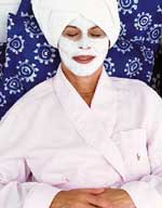 Woman in Bed wearing Facial Mask