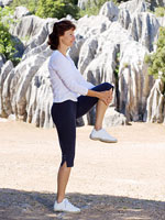 woman with knee bent stretching