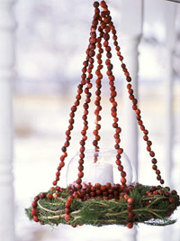 hanging wreath with berry straps and candle
