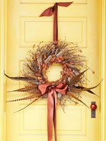 Twig wreath with dried flowers and pheasant feathers