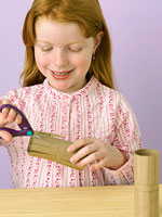 Girl cutting a paper roll