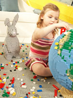Girl building a Lego globe