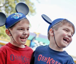 Little boys wearing Mickey ears