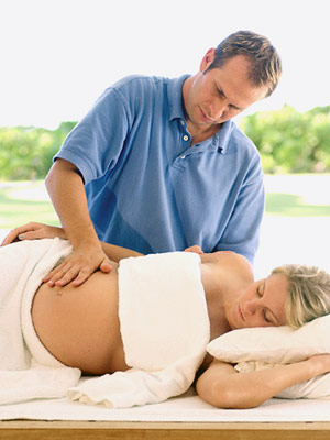 pregnant woman getting prenatal massage