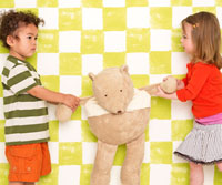 boy and girl fighting over a stuffed animal