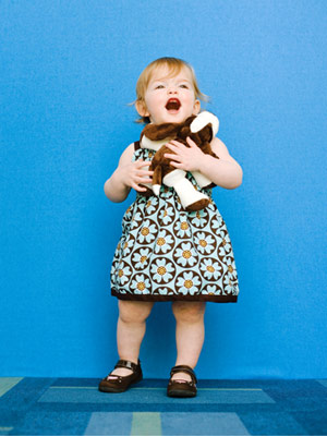 pudgy toddler holding stuffed animal