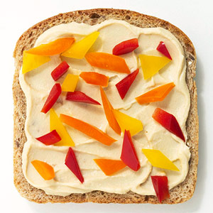 Hummus and chopped pepper sandwich